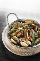 mediterranean clam and vegetable stew in pot at barcelona restaurant photo