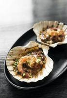 spicy tomato sauce baked prawns in clam shell creative tapas photo