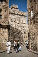 Sanaa, Yemen, 2021 - Street scene and buildings in old town photo