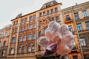 Old brick house and balloons, St-Petersburg, Russia. 19 September 2021 photo