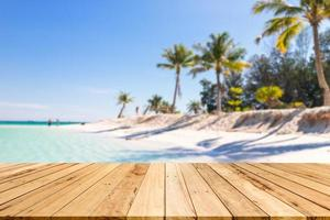 wood table background of free space for decoration and summer landscape.Wood table with blurred sea and coconut tree background. photo