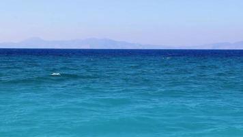 Kremasti beach Rhodes Greece turquoise water and Turkey view. video