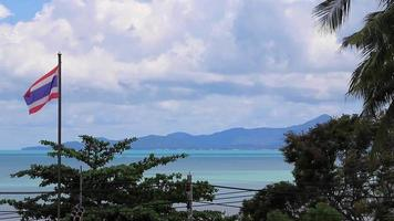 Koh Samui island beach and landscape panorama with Thailand flag. video