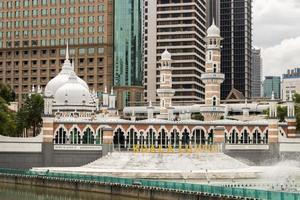 Masjid Jamek mosque and Kolam Biru in Kuala Lumpur, Malaysia photo