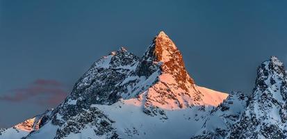 Snowy mountains with last sun summit photo