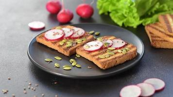 Delicious crisp sandwich with toast, radish, pumpkin seeds and flax seeds video