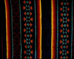 Soft and warm blanket with colorful different patterns photo
