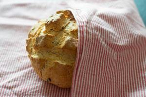 Delicious and healthy homemade bread with a red and white dish towel photo