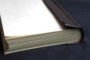 The process of book binding. Leather book spine, without the hard cover photo