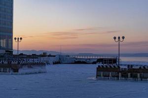 Vladivostok, Russia. Urban landscape on the background of sunset. photo