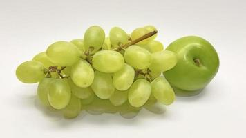 Bunch of grapes and green plum on white background photo