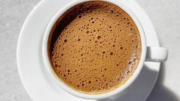 Traditional Turkish coffee in a coffee cup photo