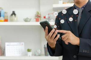 businessman holding mobile phone and checking email online. business communication smartphone on a virtual interface technology concept photo