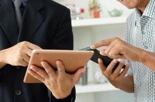 businessman use mobile phones and tablets for business communication or online marketing. photo
