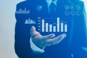 Business virtual screen technology huge data man hand icon graph and chart photo