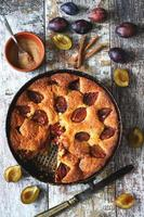 Slice of plum pie on a fork. Homemade American plum pie. photo