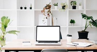 Workplace mockup concept. Mock up modern home decor desktop computer with vintage books, houseplant. Artist workspace with copy space for products display montage.Mockup desktop. photo