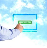 Hand pressing online insurance photo
