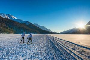 Couple man and woman cross-country skiers with skating technique photo
