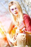 Girl plays guitar photo