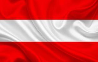 Austria country flag on wavy silk fabric background photo