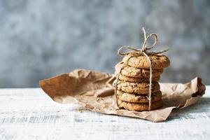 Stack of delicious cookies tied with twine lies on the table photo