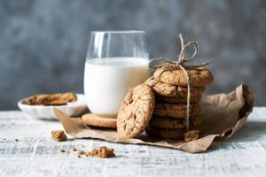 Glass of fresh milk and a stack of cookies on the table photo