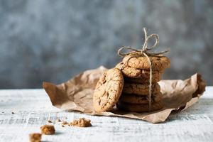 Stack of fresh cookies with chocolate lies on a table photo