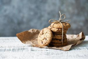 Stack of oatmeal cookies with chocolate lies on a table photo