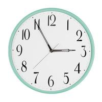 Round clock shows five minutes to three photo