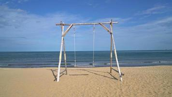 wooden swing on the beach video
