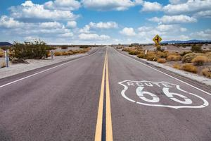 Route 66 in the desert with scenic sky. Classic vintage image with nobody in the frame. photo