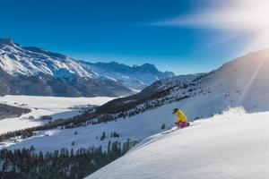 Girl in off-piste skiing photo