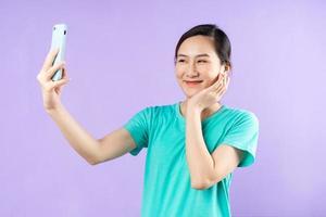 beautiful asian woman portrait, isolated on purple background photo