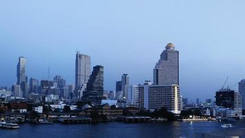 Chao Phraya River and Bangkok cityscape in Thailand. Evening sky. photo