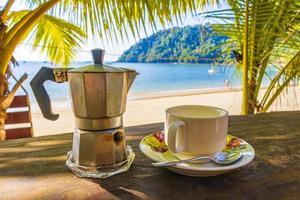 Drinking coffee in tropical Beach paradise on Koh Phayam Thailand photo