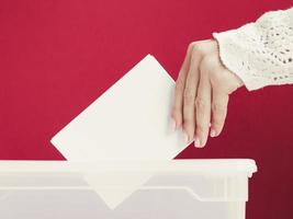 woman putting card mock up box election photo