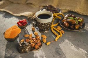 coffee cup  dates fruit different nuts photo