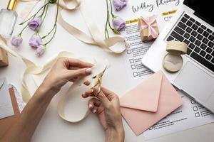 feminine hands creating handmade invitations photo