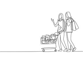 One continuous line drawing two happy friend women pushing trolley and holding paper bags when shopping together at super market. Shopping in hypermarket concept. Single line draw design illustration vector