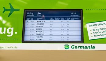 Germania Airlines green timetable for departures arrivals Airport Bremen Germany. photo