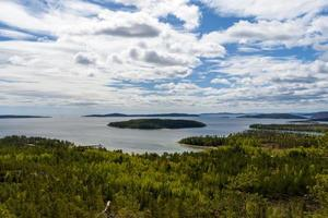 View from the High Coast area i Vasternorrland Sweden with a island in center. photo