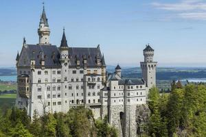Neuschwanstein castle in Germany from south with a blue sky in background. photo