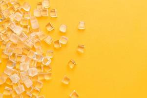 ice cubes, cold on a yellow background photo