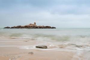 Cloudy morning, sea water, reefs and islands photo