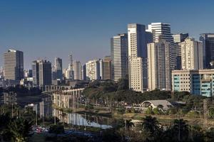 City skyline, with Marginal Avenue and Pinheiros River in the foreground, in the south zone of Sao Paulo, Brazil photo
