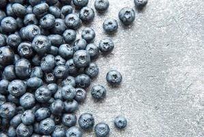 Blueberries on concrete background photo