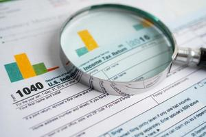 Tax Return form 1040 and dollar banknote, U.S. Individual Income. photo