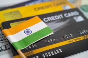India flag on credit card. Finance development, Banking Account, Statistics, Investment Analytic research data economy, Stock exchange trading, Business company concept. photo