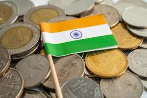 India flag on coins background, finance and accounting, banking concept. photo